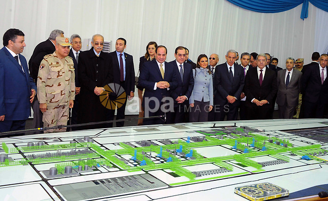 Egyptian President Abdel Fattah al-Sisi looks at mockups of natural gas extraction facilities during the inauguruation of the offshore Zohr gas field in the northern Suez canal city of Port Said, on January 31, 2018. At the ceremony attended by Sisi, Molla said the country expected to save $2.8 billion annually by ceasing to import liquified natural gas following production from the field discovered in 2015 by Italian energy giant Eni, with an initial 350 million cubic feet (10 million cubic metres) a day. Photo by Egyptian President Office