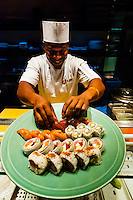 A chef prepares a plate of sushi at the sushi bar, at Nobu Restaurant, Cape Town, South Africa. There are 22 Nobu locations around the world. The original is in Beverly Hills, California.
