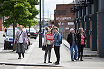© Joel Goodman - 07973 332324 . 30/07/2016 . Liverpool , UK . People looking for an Owen Smith rally are redirected to a field off Bridgewater Street in Liverpool after the booked venue , the Camp and Furnace warehouse (pictured behind) , reportedly cancelled the booking . Smith is campaigning to replace Jeremy Corbyn as the leader of the Labour Party . Photo credit : Joel Goodman