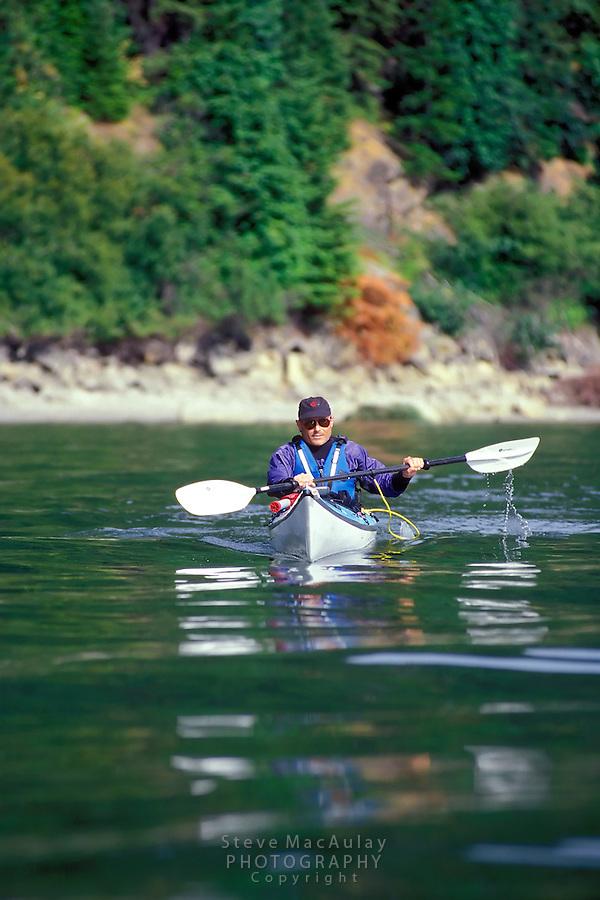 Male sea kayaker, Cypress Island, San Juan Islands, Washington
