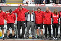 Pictured: Manager for Swansea Brendan Rodgers (C) with coaching staff observes a minute's silence in tribute to the four dead miners of Gleision Colliery in Cilybebyll, Pontardawe. Saturday 17 September 2011<br /> Re: Premiership football Swansea City FC v West Bromwich Albion at the Liberty Stadium, south Wales.