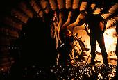 Fazenda Brasileiro, Brazil. Workers in a deep,dark gold mine.