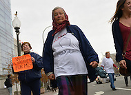 November 23, 2011  (Washington, DC)  Margaret Human (center), from upstate New York, marches with a small group of OccupyDC protesters who marched to the U.S. Capitol in Washington.  (Photo by Don Baxter/Media Images International)