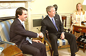 United States President George W. Bush meets with  President Jose Maria Aznar of Spain in the Oval Office of the White House in Washington, D.C. on January 14, 2004.<br /> Credit: Greg E. Mathieson / Pool via CNP