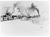 Rotary snowplow being pushed by 2 engines through light snow.<br /> D&amp;RGW