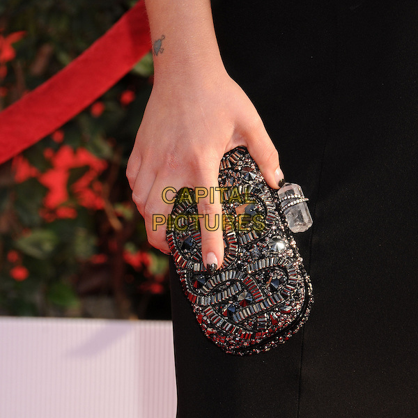 Kelly Osbourne's bag.Arrivals at the 19th Annual Screen Actors Guild Awards at the Shrine Auditorium in Los Angeles, California, USA..27th January 2013.SAG SAGs headshot portrait black   beads beaded clutch bag.CAP/ADM/BP.©Byron Purvis/AdMedia/Capital Pictures