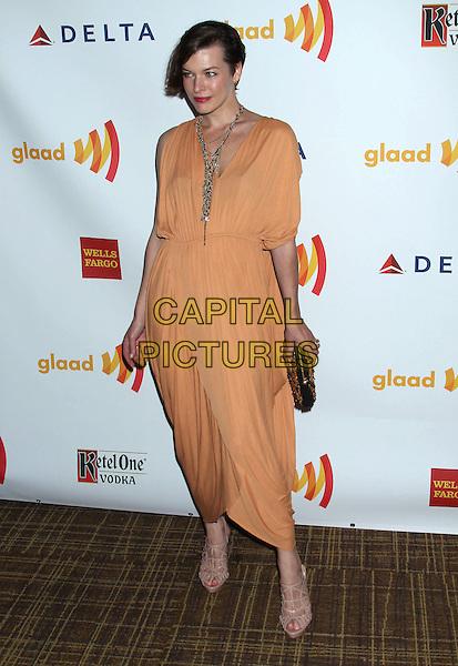 Milla Jovovich.23rd Annual GLAAD Media Awards held at the Westin Bonaventure Hotel, Los Angeles, California, USA..April 21st, 2012.full length orange dress necklace silver  .CAP/ADM/RE.©Russ Elliot/AdMedia/Capital Pictures.