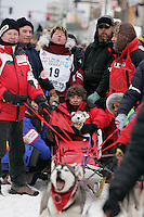 Karen Ramstead howls for her dogs as she waits at the start line in Anchorage on Saturday March 1st during the ceremonial start day of the 2008 Iidtarod Sled Dog Race.