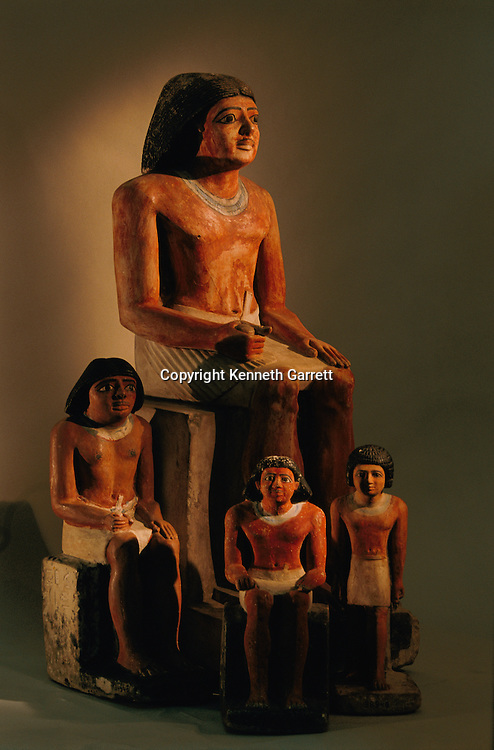 Four painted limestone statues of the artisan Inty-Shedu, Old Kingdom