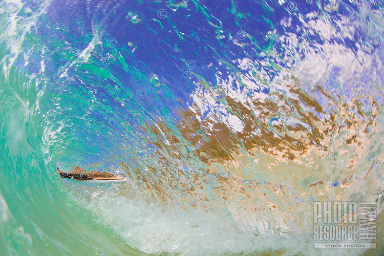 A wave barrels at Gas Chambers on Oahu's Sandy Beach.