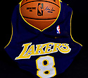 MIRAMAR, FLORIDA - JANUARY 27: (EXCLUSIVE) Kobe Bryant #8 Lakers Jersey photograph draping over a Spalding NBA basketball. Nine people were killed in the helicopter crash which claimed the life of NBA star Kobe Bryant and his 13 year old daughter Gianna Maria-Onore Bryant, on January 26, 2020. Los Angeles officials confirmed on Sunday. Los Angeles County Sheriff Alex Villanueva said eight passengers and the pilot of the aircraft died in the accident. The helicopter crashed in foggy weather in the Los Angeles suburb of Calabasas. Authorities said firefighters received a call shortly at 9:47 am about the crash, which caused a brush fire on a hillside. in Miramar, Florida, USA.  ( Photo by Johnny Louis / jlnphotography.com )
