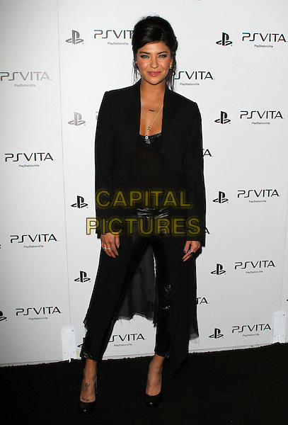Jessica Szohr.Sony PlayStation® Unveils PS VITA Portable Entertainment System. Held At Siren Studio, Los Angeles, California, USA..January 15th, 2012.full length black jacket leather trousers top  .CAP/ADM/KB.©Kevan Brooks/AdMedia/Capital Pictures.