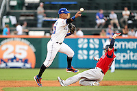 Buffalo Bisons shortstop Ronny Cedeno #10, on rehab assignment from the NY Mets, attempts to turn a double play as Cody Ross slides in during a game against the Pawtucket Red Sox at Coca-Cola Field on June 16, 2012 in Buffalo, New York.  (Mike Janes/Four Seam Images)
