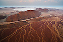 Namibia, Namib Desert, aerial view of mountains and dry creek beds near Messum Crater, sunrise