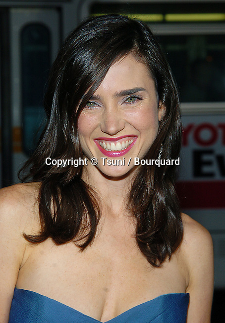 Jennifer Connelly arriving at the Wimbledon Premiere at the Samuel Goldwyn Theatre Academy of Motion Pictures Arts and Sciences in Los Angeles. September 13, 2004.