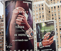 Advertising for the Samsung Galaxy Note 3 + Gear smartphone  in the Herald Square neighborhood of New York on Sunday, January 26, 2014.  (© Richard B. Levine)