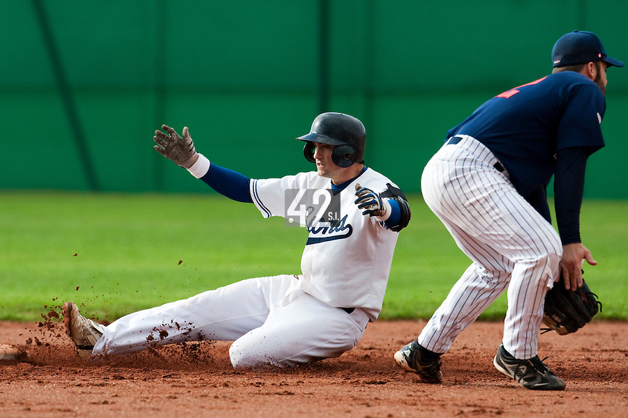 10 october 2009: Florian Peyrichou of Savigny slides safely into second base as Dany Scalabrini of Rouen fails to tag him during game 3 of the 2009 French Elite Finals won 4-2 by Savigny over Rouen, at Stade Jean Moulin stadium in Savigny sur Orge, near Paris, France.