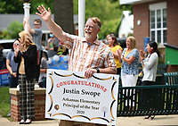 Lee Elementary School principal Justin Swope waves to passing well wishers Thursday, May 21, 2020, from the parking lot of the school in Springdale. Swope was recognized as the Arkansas Elementary Principal of the Year 2020 by the Arkansas Association of Elementary School Principals. Swope has been the principal at Lee Elementary School for nine years. Check out nwaonline.com/200522Daily/ and nwadg.com/photos for a photo gallery.<br /> (NWA Democrat-Gazette/David Gottschalk)