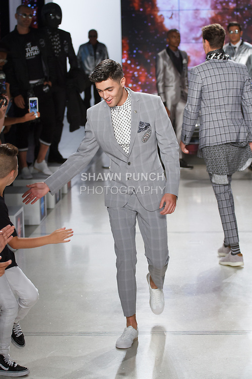 "Model walks runway in an outfit from the Nick Graham Spring Summer 2019 ""1969"" collection in at Cadillac House in New York City on July 10, 2018; during New York Fashion Week: Men's Spring Summer 2019."