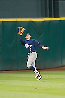 Rice Owls center fielder John Williamson #8 catches a fly ball against the Texas Longhorns at Minute Maid Park on February 28, 2014 in Houston, Texas.  The Longhorns defeated the Owls 2-0.  (Brian Westerholt/Four Seam Images)
