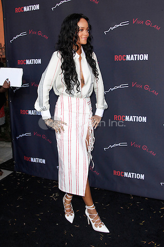 LOS ANGELES, CA - JANUARY 25: Rihanna at the Roc Nation Pre-Grammy brunch presented by MAC Viva Glam at a private residency on January 25, 2014 in Los Angeles, California. Credit: Star Shooter/MediaPunch