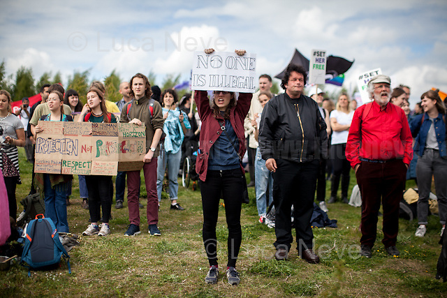 Bedford (Bedfordshire, England), 13/05/2017. Today, more than two thousand activists and members of the public from across the UK gathered outside the notorious Yarl's Wood I.R.C. Immigration Removal Centre in Bedfordshire, lead by the &quot;Movement for Justice By Any Means Necessary&quot; to protest against the alleged inhuman conditions of the 400+ detainees (showed in a Channel 4 undercover investigation - http://bit.ly/1E6X4pz) and to call for immediate closure of all detention centres. &lt;&lt;Yarl's Wood Immigration Removal Centre is a detention centre for foreign nationals prior to their deportation from the United Kingdom, one of 13 such centres currently in the UK. It is located near Milton Ernest in Bedfordshire, England, and is operated by Serco (British outsourcing company based in Hook, Hampshire. It operates public and private transport and traffic control, aviation, military weapons, detention centres, prisons and schools on behalf of its customers - Source Wikipedia.org), who describes the place as &quot;a fully contained residential centre housing adult women and adult family groups awaiting immigration clearance.&quot; Its population is, and has been, overwhelmingly female. [&hellip;] &gt;&gt; (Source - Wikipedia.org at http://bit.ly/1GiTFWB). The protest of today was the 11th demo organised at Yarl's Wood and the largest ever at a detention centre in the UK. Mabel Gawanas, 43 - the longest-serving detainee at Yarl's Wood: three years - attended the demo, gave a speech and chatted on the phone offering her support and solidarity with the people detained (For an article about Mabel Gawanas please click here: https://goo.gl/3JCTCB - Source, Bedfordshire On Sunday).<br /> <br /> For more information please click here: https://www.facebook.com/events/1397760473581688/&amp; http://www.movementforjustice.org/ &amp; https://twitter.com/followMFJ