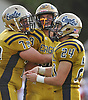 Mark Rossini #88 of Bethpage, center, celebrates with teammates Eric Hakobjanyan #72, left, and Chris Greco after the final play of their 28-21 win over Plainedge in a Nassau County Conference III varsity football game played at Bethpage High School on Saturday, Oct. 21, 2017.
