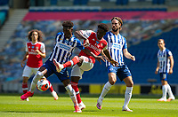 20th June 2020, American Express Stadium, Brighton, Sussex, England; Premier League football, Brighton versus Arsenal ;  Brighton and Hove Albions Yves Bissouma vies with Arsenals Bukayo Saka for the ball