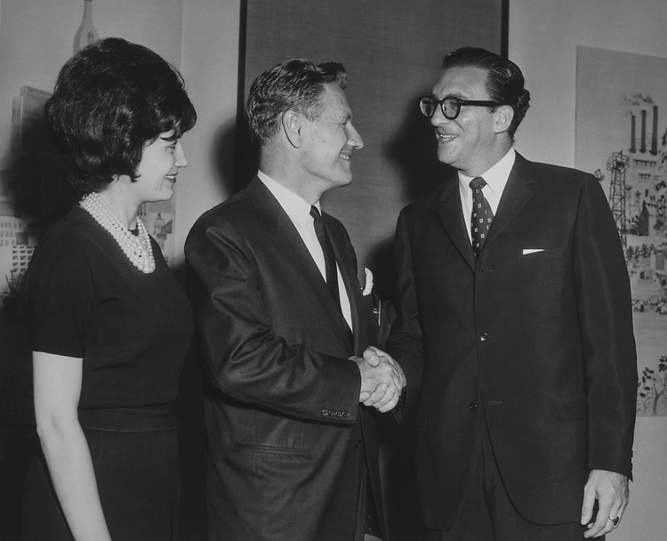 Chairman David Rockefeller shaking hands with Journalist, Sid Yudain. (Photo by CQ Roll Call via Getty Images)