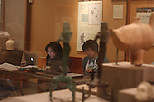 1050 – University of Chicago students take advantage of the Oriental Museum's study night Sunday evening to get some last minute studying done. The Oriental Institute is located at 1155 E. 58th Street.