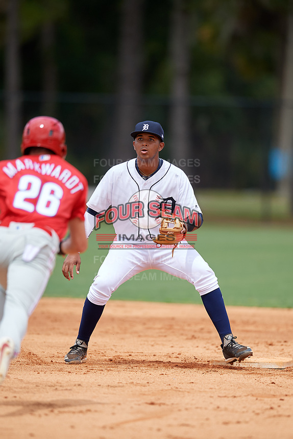 Detroit Tigers shortstop Carlos Irigoyen (43) waits for a throw as as Hunter Markwardt (26) slides into second base during an Instructional League game against the Philadelphia Phillies on September 19, 2019 at Tigertown in Lakeland, Florida.  (Mike Janes/Four Seam Images)
