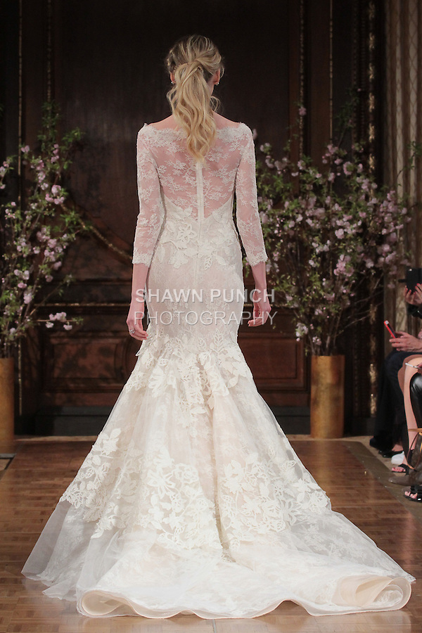 """Model walks runway in a """"Brooke"""" bridal gown from the Isabelle Armstrong Spring Collection 2017, at Lotte New York Palace Hotel, during New York Bridal Fashion Week Spring Summer 2017 on April 16, 2017."""