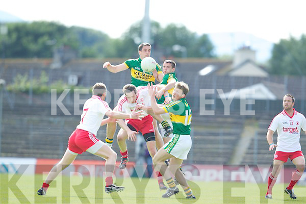 Anthony Maher, Shane Enright and Donnchadh Walsh Kerry in Action against Colm Cavanagh Tyrone in Round Three of Qualifiers at Fitzgerald Stadium on Saturday 21st July 2012.