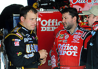 May 1, 2009; Richmond, VA, USA; NASCAR Sprint Cup Series driver Ryan Newman (left) talks with teammate Tony Stewart during practice for the Russ Friedman 400 at the Richmond International Raceway. Mandatory Credit: Mark J. Rebilas-
