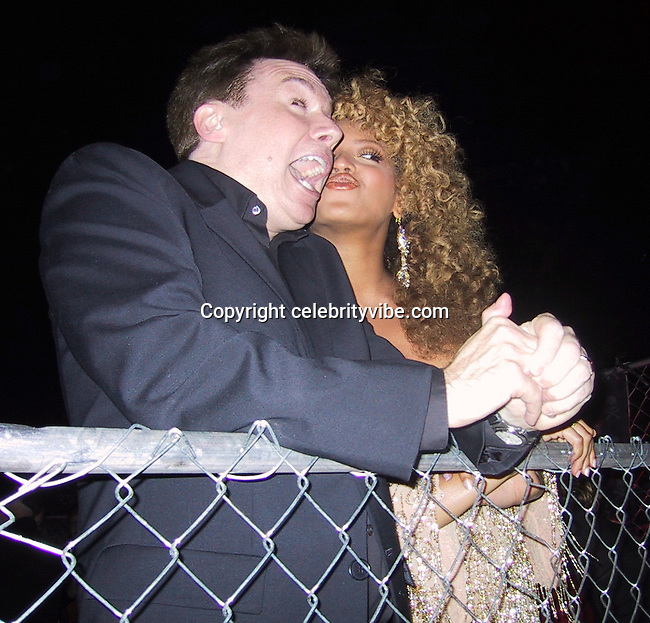 """Mike Myers & Beyonce Knowles.EXCLUSIVE.""""Austin Powers"""" Post Premiere Party.Universal Studios.Hollywood, CA.July 22, 2002.Photo By Celebrityvibe.com.."""