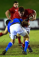 Wales U20's Rhys Carre is tackled by Italy U20's Nicolo Casilio<br /> <br /> Photographer Richard Martin-Roberts/CameraSport<br /> <br /> Six Nations U20 Championship Round 4 - Wales U20s v Italy U20s - Friday 9th March 2018 - Parc Eirias, Colwyn Bay, North Wales<br /> <br /> World Copyright &not;&copy; 2018 CameraSport. All rights reserved. 43 Linden Ave. Countesthorpe. Leicester. England. LE8 5PG - Tel: +44 (0) 116 277 4147 - admin@camerasport.com - www.camerasport.com