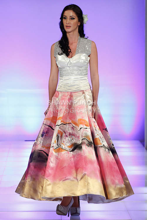 Singer Veronica Iovan performs on the runway, runway in an outfit from the Alexandra Popescu-York collection, during Couture Fashion Week Fall 2014, on February 16, 2014.
