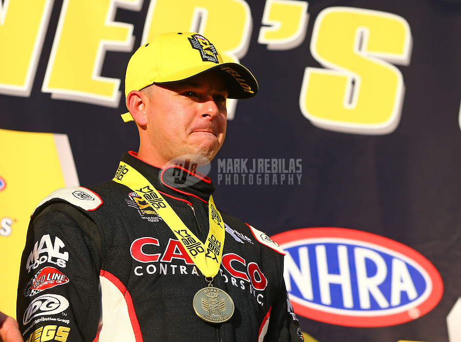 Feb 14, 2016; Pomona, CA, USA; NHRA top fuel driver Steve Torrence celebrates after winning the Winternationals at Auto Club Raceway at Pomona. Mandatory Credit: Mark J. Rebilas-USA TODAY Sports