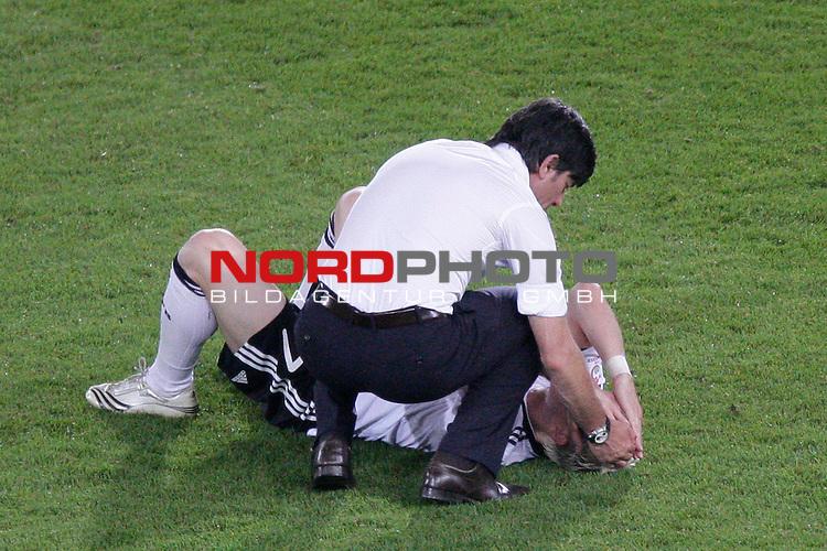 UEFA Euro 2008  Finale<br /> <br /> Vienna - Ernst Happel Match 32<br /> Deutschland ( GER ) - Spanien ( ESP ) 0:1<br /> <br /> Niedergeschlagenheit bei den Deutschen<br /> <br /> Joachim Loew (L&ouml;w) - ( Germany / Trainer / Coach / ) troestet Bastian Schweinsteiger ( Germany / Mittelfeldspieler / Midfielder /  Bayern Muenchen #7)<br /> <br /> <br /> <br /> Foto &copy; nph (  nordphoto  )<br /> <br /> <br /> <br />  *** Local Caption ***