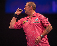 21.12.2014.  London, England.  William Hill World Darts Championship.  Dean Winstanley (26) [ENG] in action during his game with Wayne Jones [ENG]. Winstanley won the match 3-2