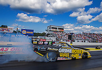 Aug 15, 2014; Brainerd, MN, USA; NHRA funny car driver Jeff Arend during qualifying for the Lucas Oil Nationals at Brainerd International Raceway. Mandatory Credit: Mark J. Rebilas-