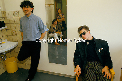 Peter Gill and Mark O'Toole,of Franklie Goes to Hollywood. Groupies seen in mirror. Dressing room TV studio Munich promotional tour. 1983.