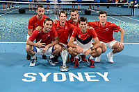 12th January 2020; Sydney Olympic Park Tennis Centre, Sydney, New South Wales, Australia; ATP Cup Australia, Sydney, Day 10; Serbia versus Spain; ATP Cup final ceremony; Novak Djokovic and Team Serbia pose with the ATP Cup trophy after defeating Team Spain - Editorial Use