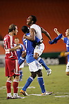 Aug 22 2007:  Scott Sealy (19) of the Wizards jumps into the arms of teammate Eddie Johnson to celebrate his goal, as Justin Mapp of the Fire sadly looks on.  The MLS Kansas City Wizards defeated the visiting Chicago Fire 3-2 at Arrowhead Stadium in Kansas City, Missouri, in a regular season league soccer match.
