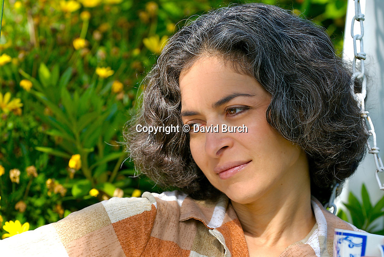 Mature woman sitting outside in contemplative mood