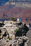 COUPLE PERCH DANGEROUSLY on LEDGE at the GRAND CANYON<br />