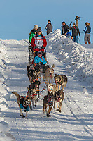 Kristin Bacon on Cordova St. hill during the Anchorage start day of Iditarod 2018 on Cordova St. hill during the Anchorage start day of Iditarod 2019