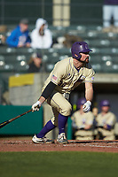 Luke Robinson (38) of the Western Carolina Catamounts follows through on his swing against the Saint Joseph's Hawks at TicketReturn.com Field at Pelicans Ballpark on February 23, 2020 in Myrtle Beach, South Carolina. The Hawks defeated the Catamounts 9-2. (Brian Westerholt/Four Seam Images)