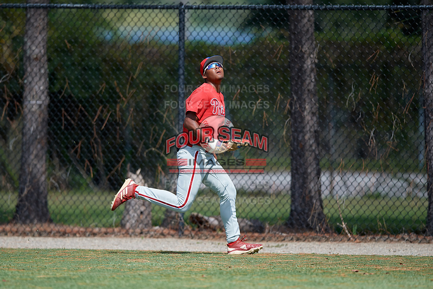 Philadelphia Phillies right fielder Marcus Lee Sang (9) tracks a fly ball during an Instructional League game against the Detroit Tigers on September 19, 2019 at Tigertown in Lakeland, Florida.  (Mike Janes/Four Seam Images)