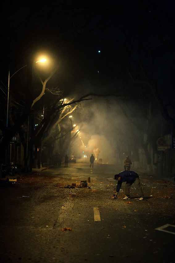 Some men are lighting firecrackers in the streets of Beijing, near the Forbidden city, thursday 3 at midnight to celebrate the chinese New lunar year 2011 (year of the rabbit).